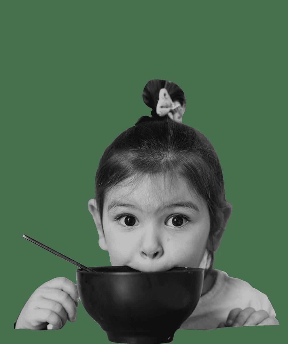 A girl eating ramen