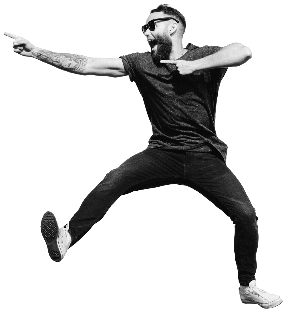 Energetic man jumping and pointing with a smile on his face